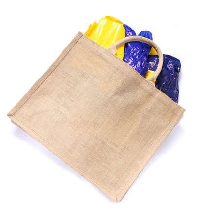 Modern ecological bag eating plastic bags