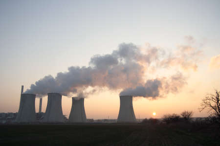 Coal power plant at sunset Stock Photo