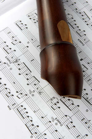 Brown wooden alt flute closeup with book with music Stock Photo - 4421540