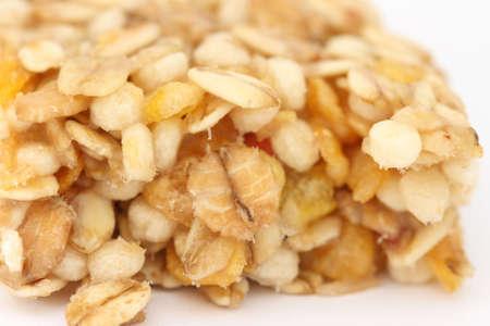Macro muesli bar close up - grain and corn flakes photo