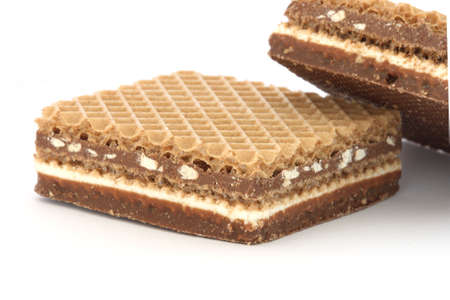 Two crunchy filled wafers with cacao cream and nuts Stock Photo - 6083662