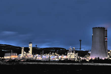 View of large petrochemical factory in early night light with shining lights