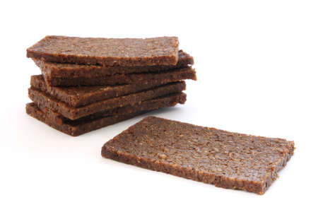 Stack of black dark bread loafs called pumprnikl - specific germa healthy whole corn read