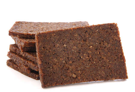 Stack of black dark bread loafs called pumprnickel - specific germa healthy whole corn read Stock Photo