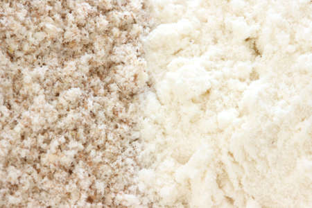 Close up view of two types of flour - whole grain  wholemeal and smooth