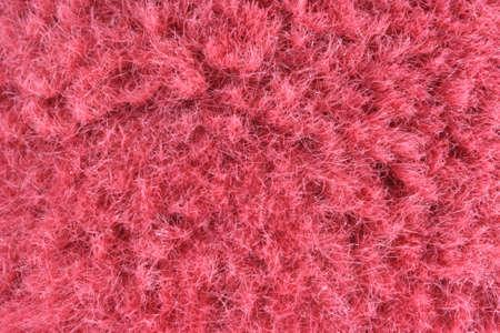 porno: Vista della trama del tessuto rosso peloso - pelliccia vicino come abbigliamento Archivio Fotografico