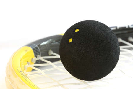 Squash rocket with two-yeallow dotted black ball Stock Photo