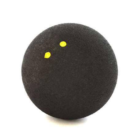 Squash ball with two yellow dots on white background