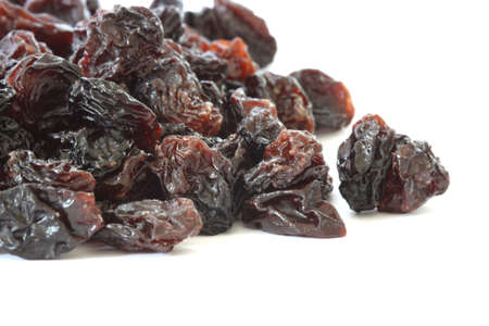 Many raisins scatered on white background photo