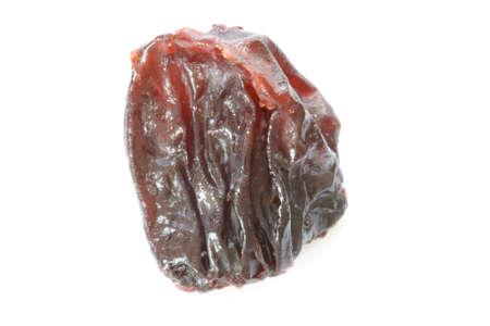 Single raisin on white background