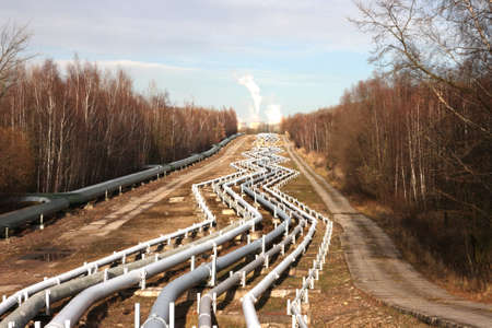 View of pipelines leading to the horizon with power-plant Stock Photo - 8582670