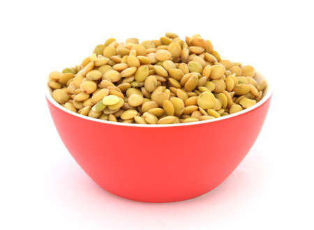 green lentil: Close up view of cooked green lentil in red bowl on white background
