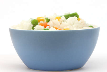 Close up view of cooked rice in blue bowl - with mixed of colorful vegetable photo