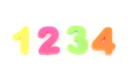 Numbers formed from plastic colourful toy digits on white background photo