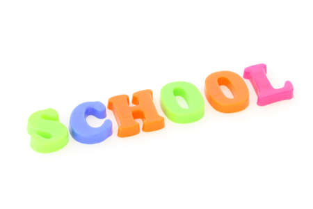 Word school formed from plastic colourful toy letters on white background photo