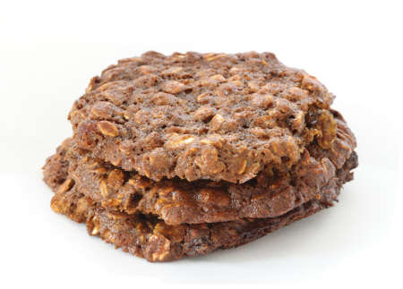 Stack of home made oatmeal cookies with molasses on white background photo