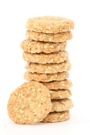 Stack of home made golden oatmeal and sesame cookies photo