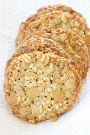 noone: Stack of whole grain biscuits with white cloth in background