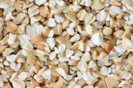 noone: Scattered view of dry raw pealed buckwheat
