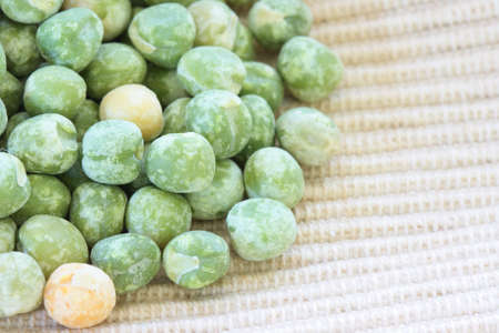 green pea: Close up view of scattered dried green pea on cloth Stock Photo