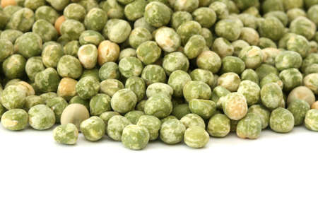noone: Close up view of scattered dried green pea on white background