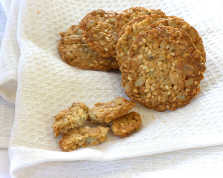 noone: Stack of whole grain biscuits on white cloth