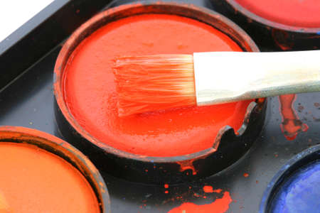 noone: Used water color paint box with a paintbrush close up Stock Photo