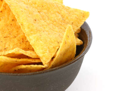noone: Mexican tortilla chips in brown bowl on white background
