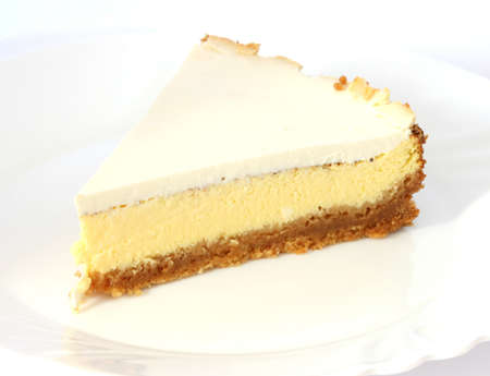 Layered cheesecake case on white plate and background photo