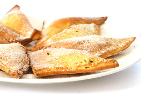 noone: Sweet baked pastry triangles on white plate