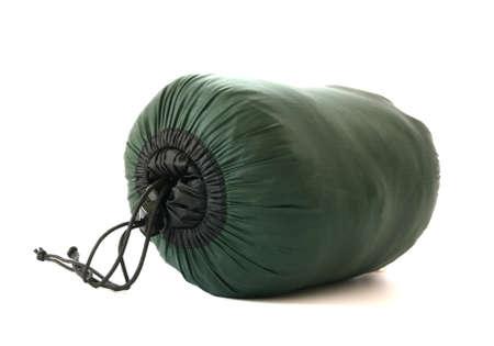Упакованные спальный мешок на белом фоне