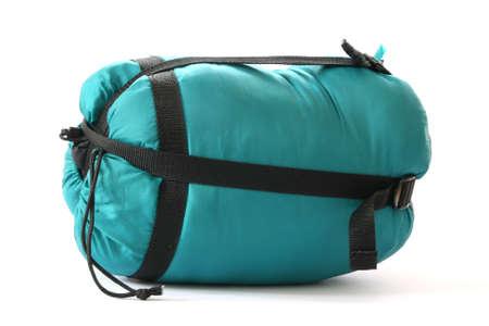 noone: Packed sleeping-bag on white background