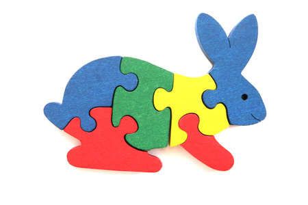 Colorful wooden rabbit puzzle toy on white background photo