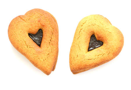 noone: Two gingerbreads in heart shapes on white background
