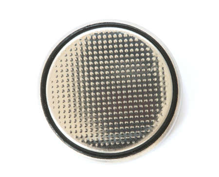 noone: Silver button cell battery on white background