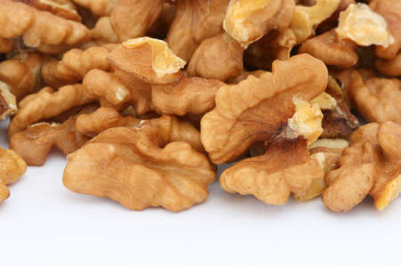 Halves of walnuts on white background