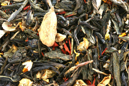 Dry black tea flavored with dry flower buds Stock Photo