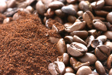 Whole and ground coffee beans scattered