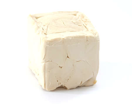 Yeast cub on white background Stock Photo