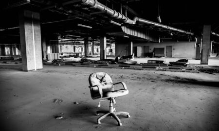 black and white dusty office seat in an abandoned building 스톡 콘텐츠