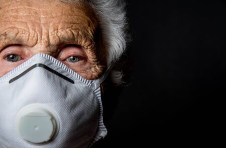 close up of an old woman wearing a PPE, FPP2 mask against virus