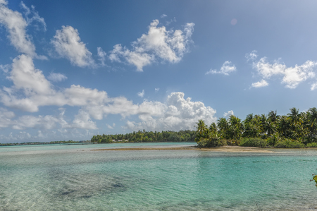 borabora: Detail of the lagoon of Borabora with a beautiful palms forest Stock Photo