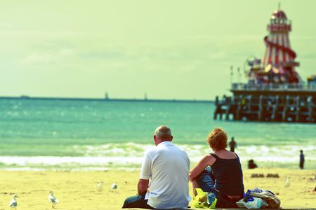 A couple enjoying bournemouth beach,cross processed with selective blur Stock Photo