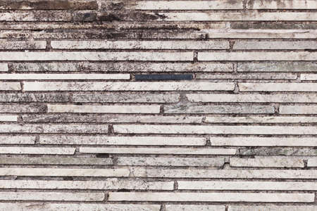 Gray brick wall background structure, surface texture in urban enviroment Stock Photo