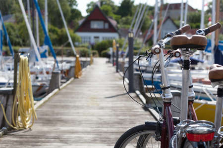 Summer at the harbor with a pair of bicycles