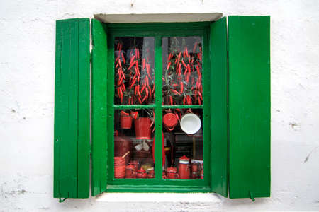 Typical window from Hondarribia with red chillies. colors Foto de archivo