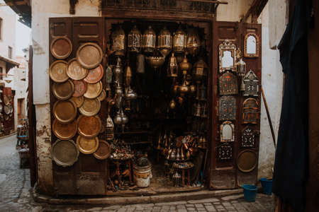Selection of traditional lamps on sale at a market stall in souks of Marrakech, Morocco.