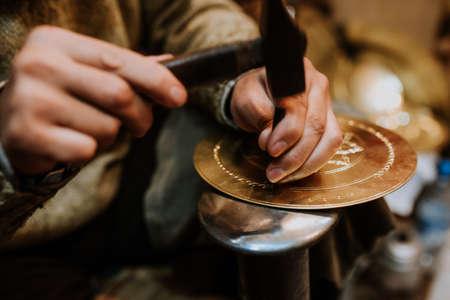 Making antique arabic handicrafts. morocco Foto de archivo