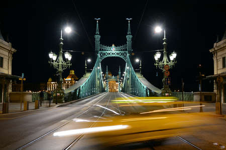 View on the traffic on the Fovam square and the Liberty Bridge at night in Budapest, Hungary. Editorial