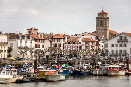 Colorful traditional basque houses in port of Saint-Jean-de-Luz Old Town, France.